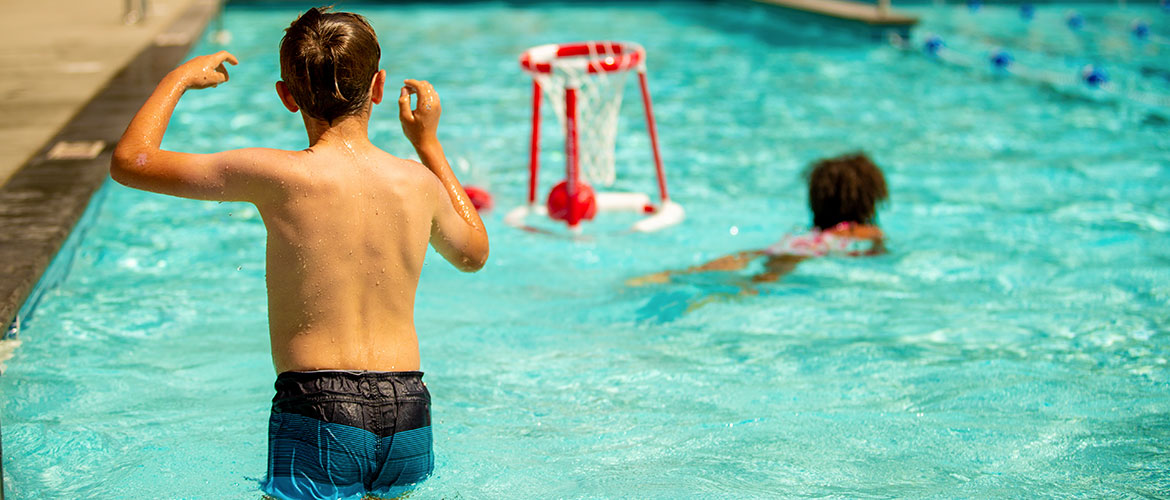kids playing in outdoor pool